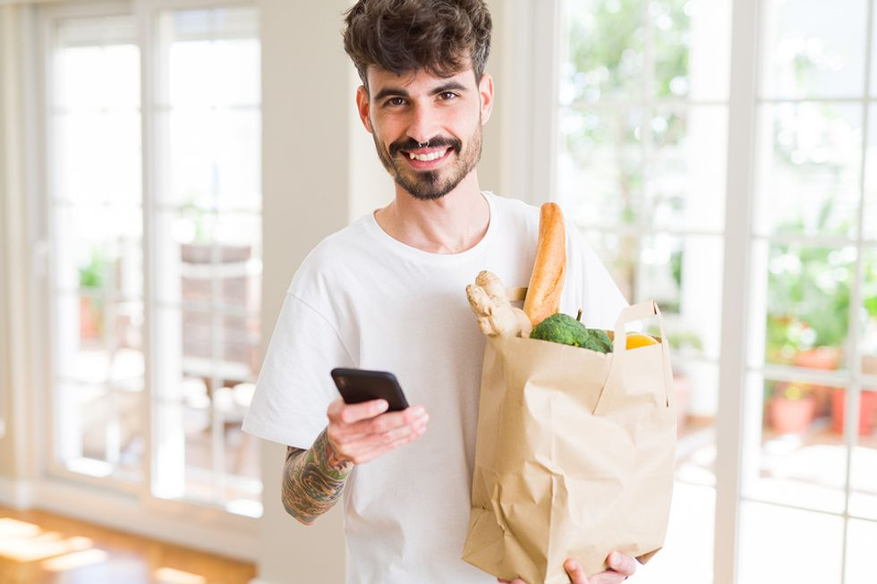 Man buys groceries for meal prep