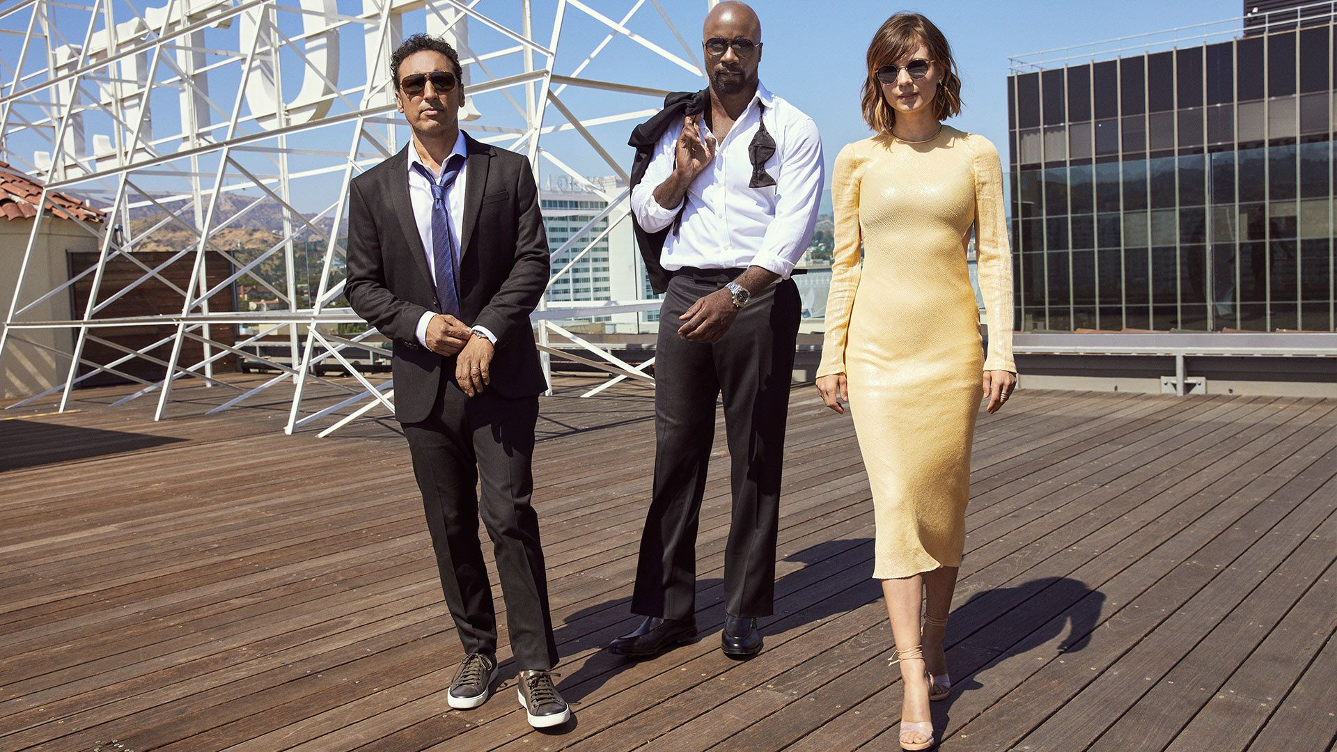 The cast of TV show Evil on a rooftop in Hollywood.