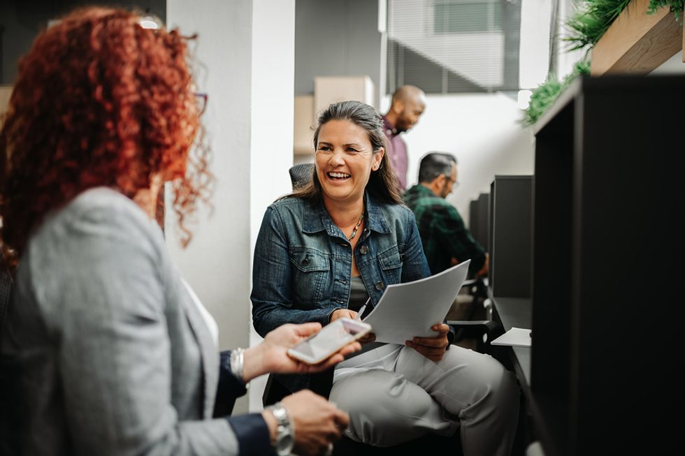 Two women in the workplace with good communication skills