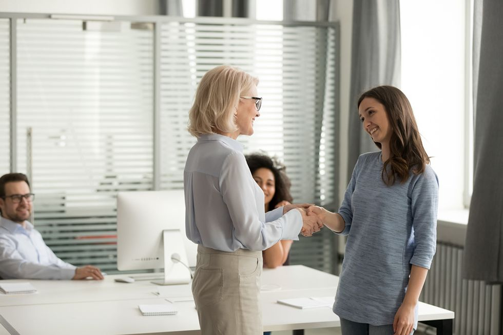 Woman shakes her new manager's hand