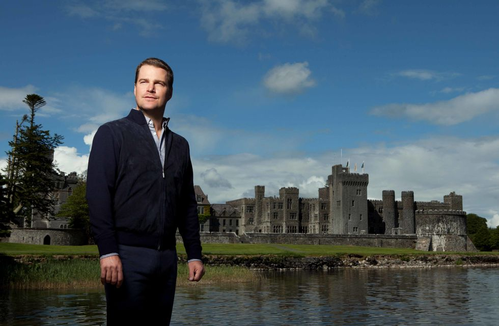 Chris O'Donnell in front of a famous castle