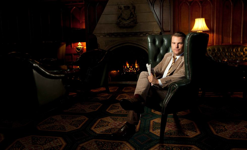 Chris O'Donnell in the sitting room of a castle-hotel lobby.
