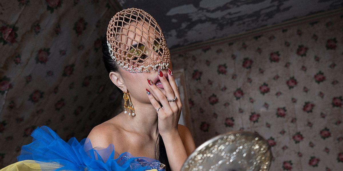 Gia Woods Serves Alice in Wonderland for 'Ego' Video