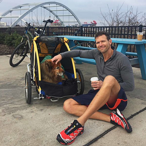 Dr. Travis Stork with a bicycle.