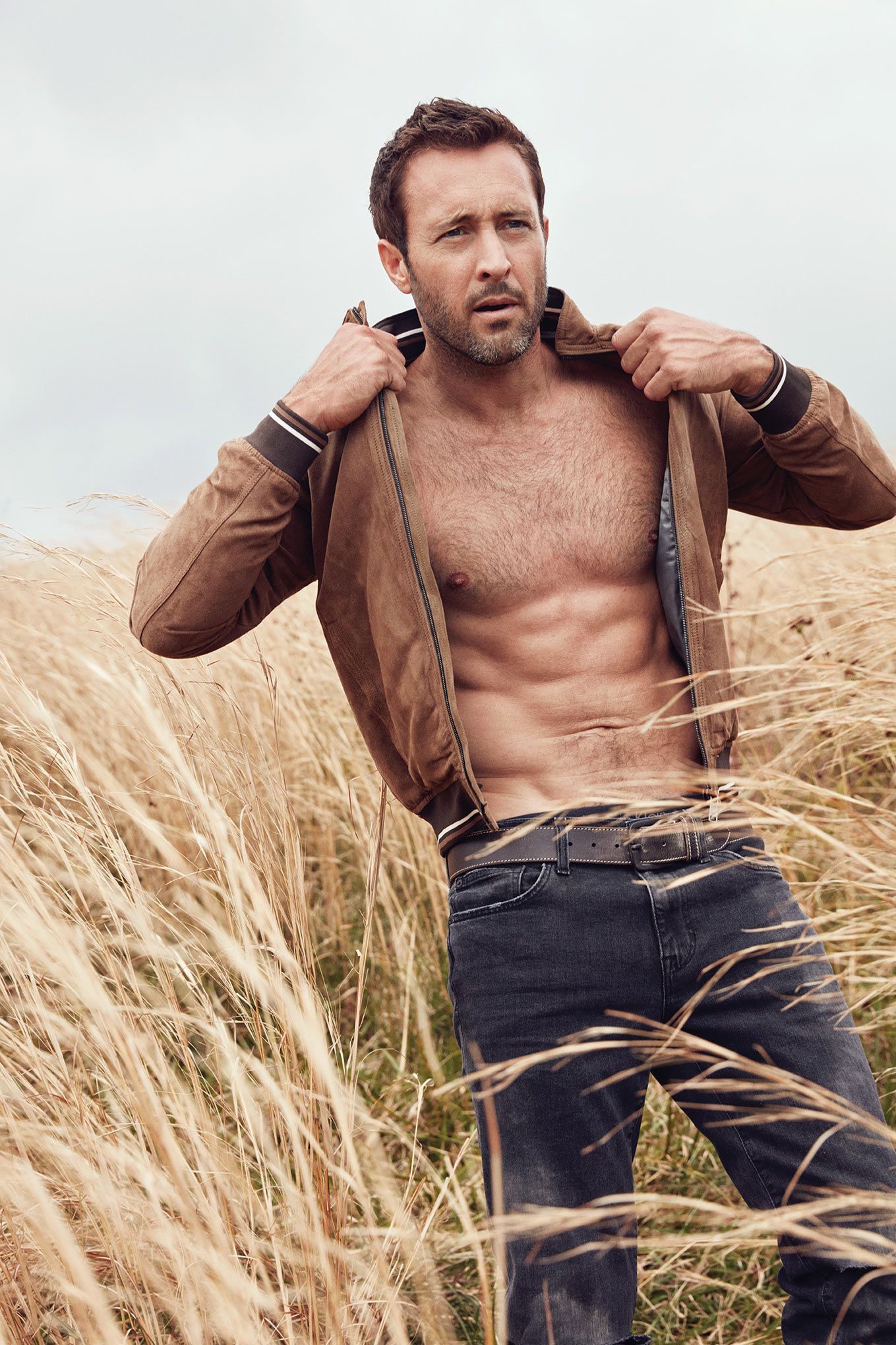Alex O loughlin shirtless with a leather jacket.