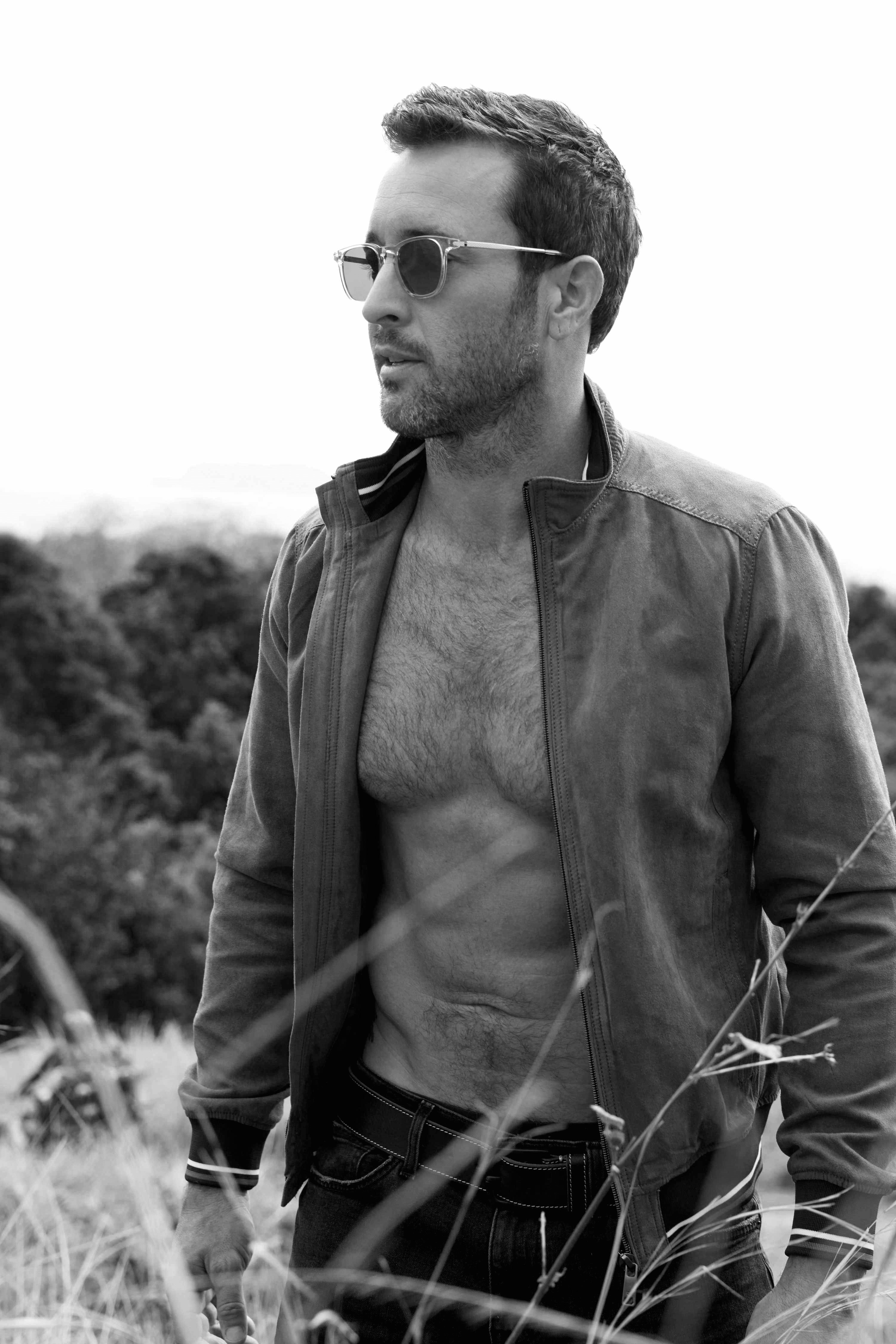 Black and white photo of Alex O'Loughlin shirtless