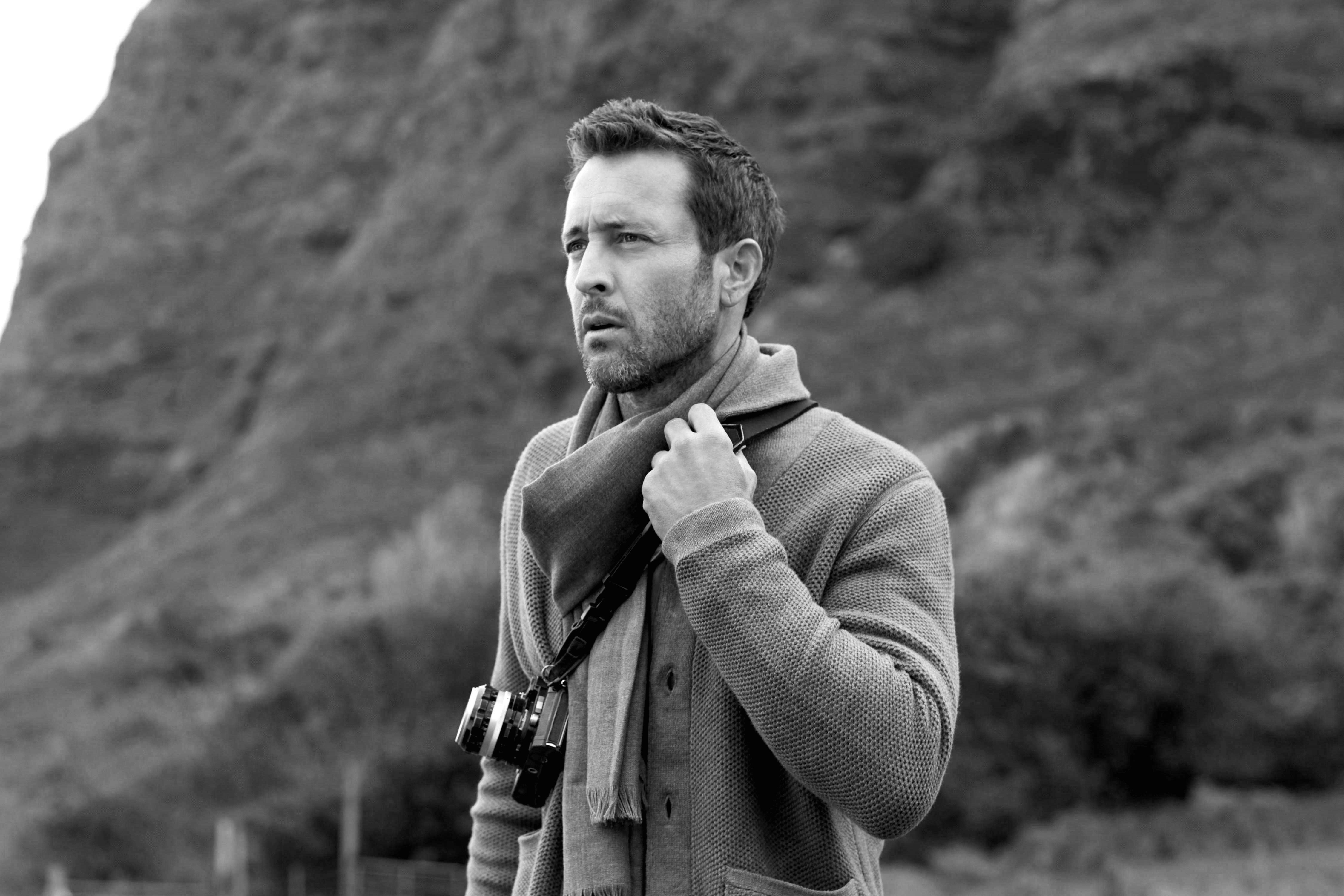 Black and white photo of Alex O'Loughlin wearing a scarf