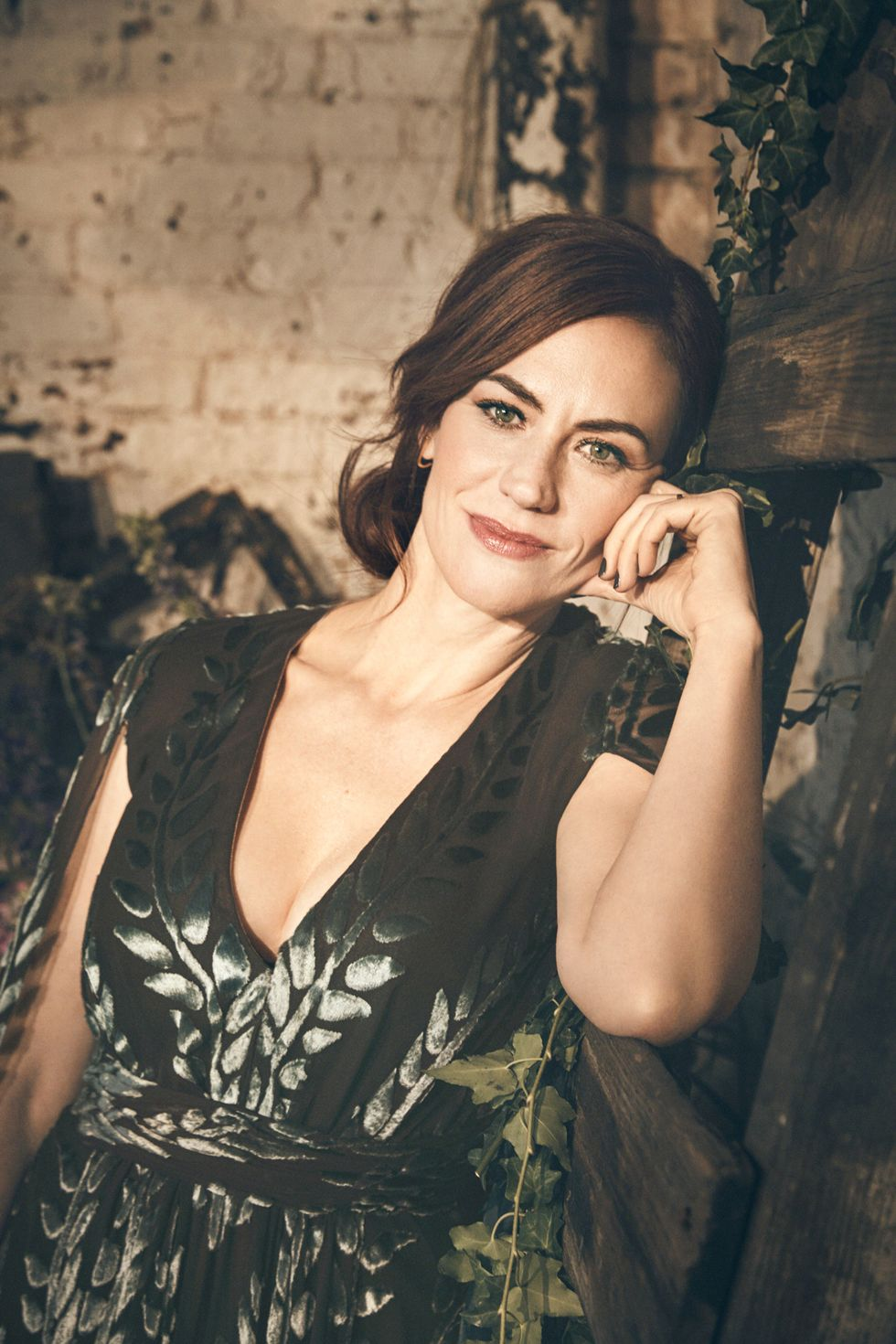 Closeup of Maggie Siff in a floral dress.