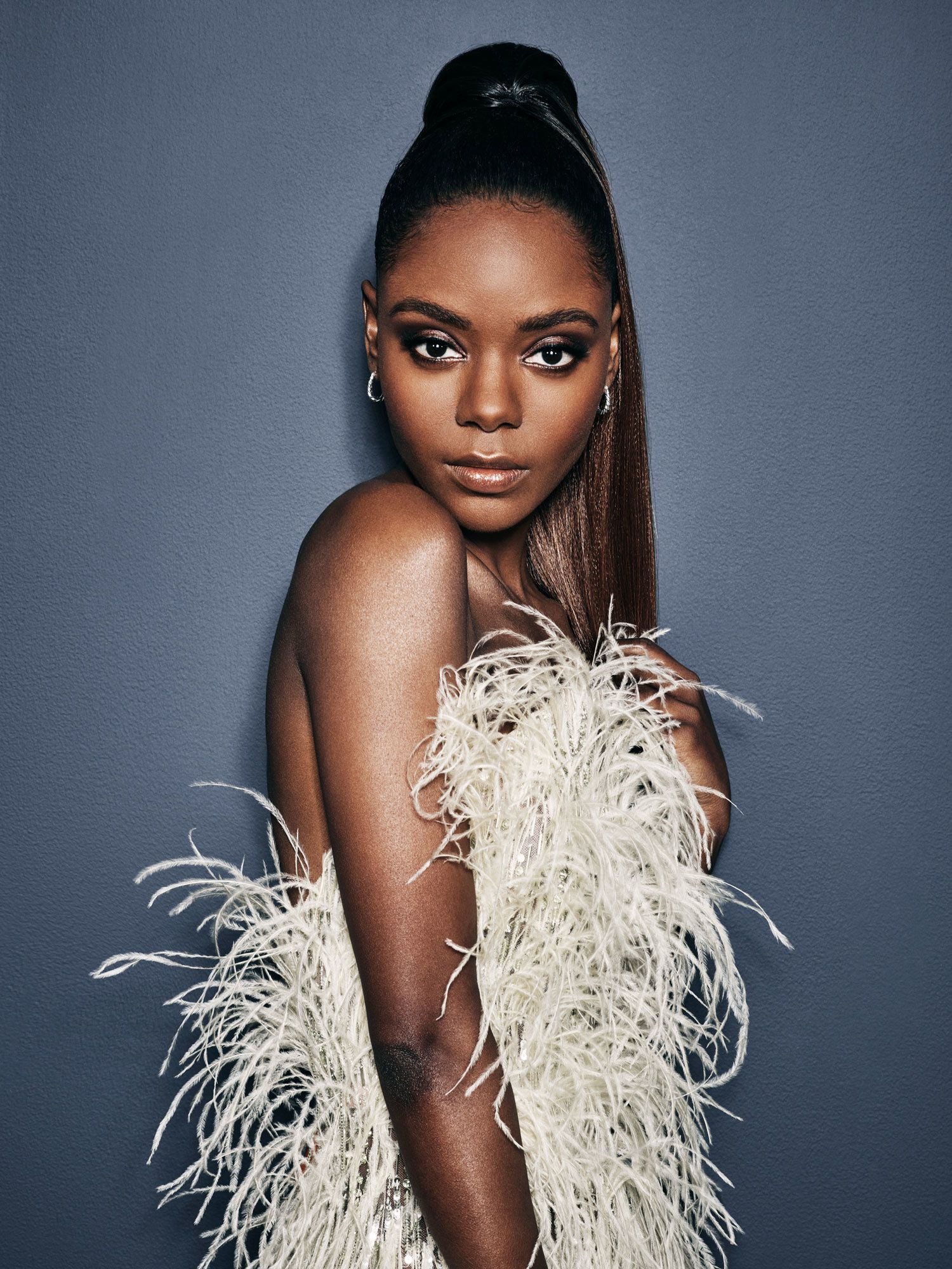 Ashleigh Murray in a feather dress.