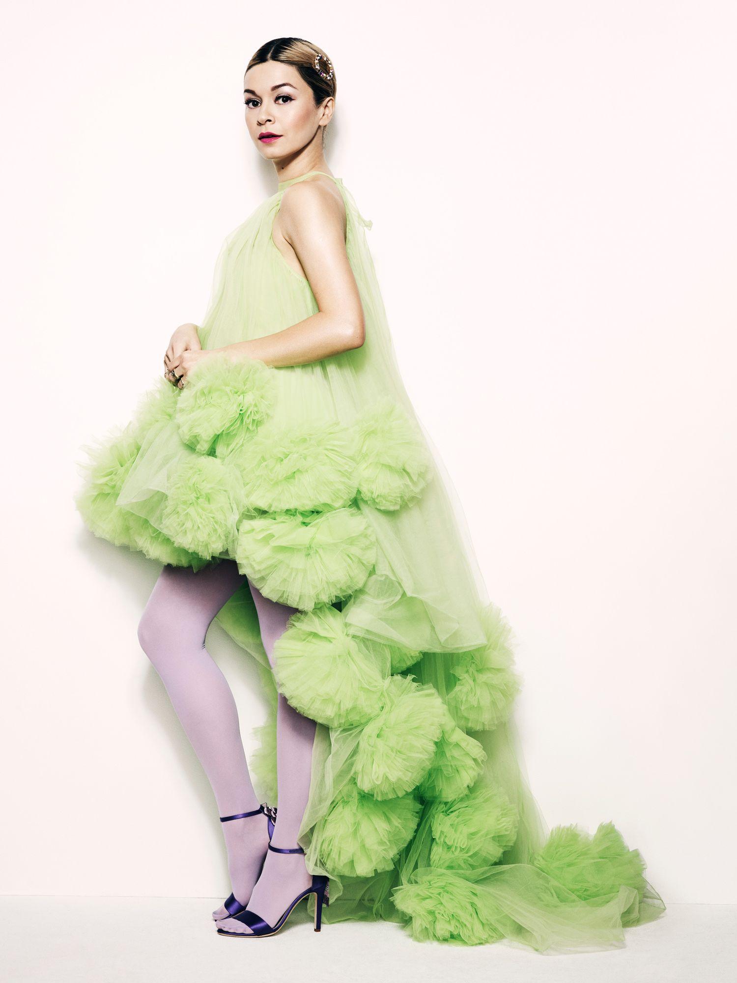 Julia Chan wearing a long, fluffy mint green gown