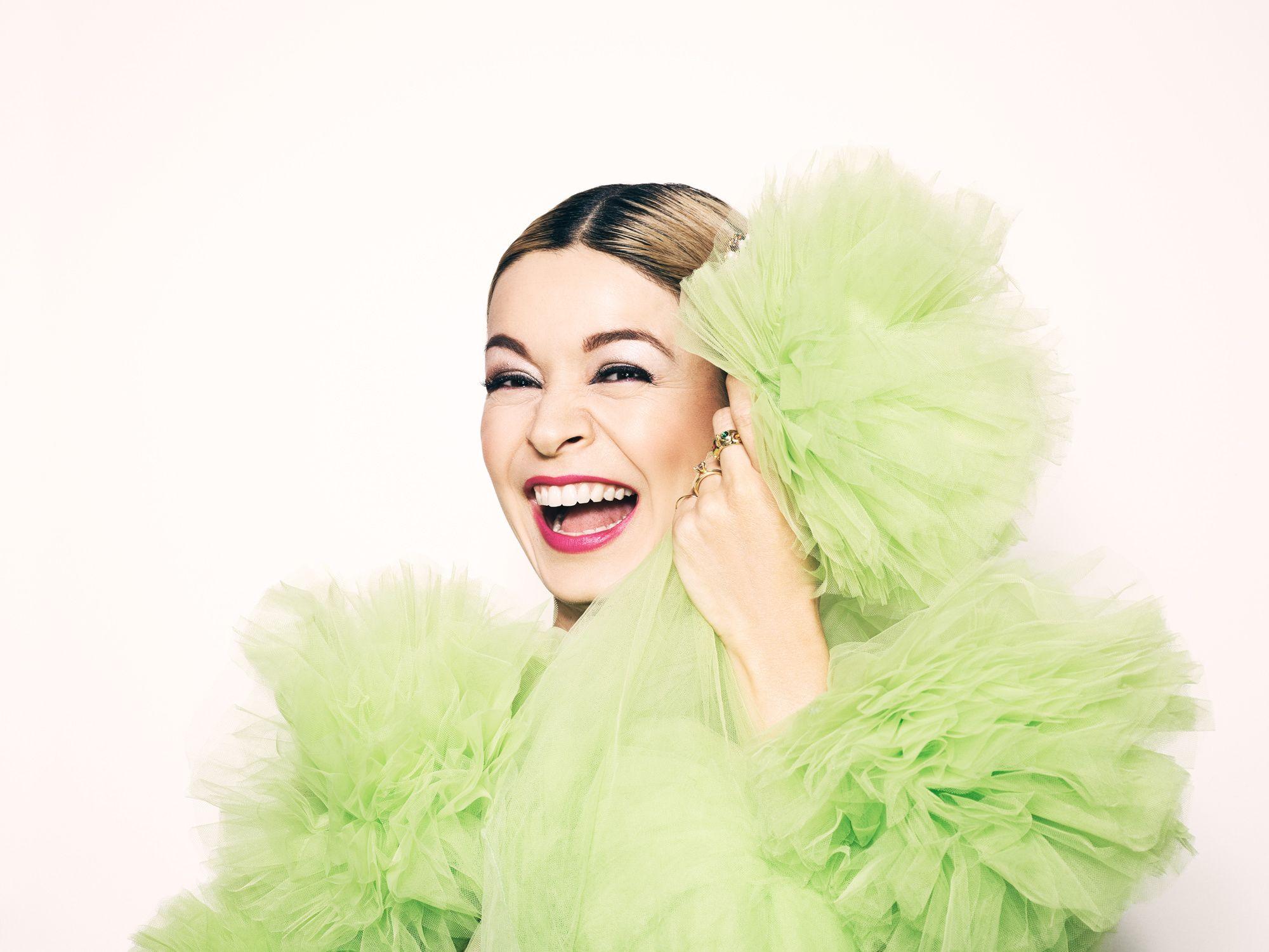 Julia Chan in a poofy mint green frock.
