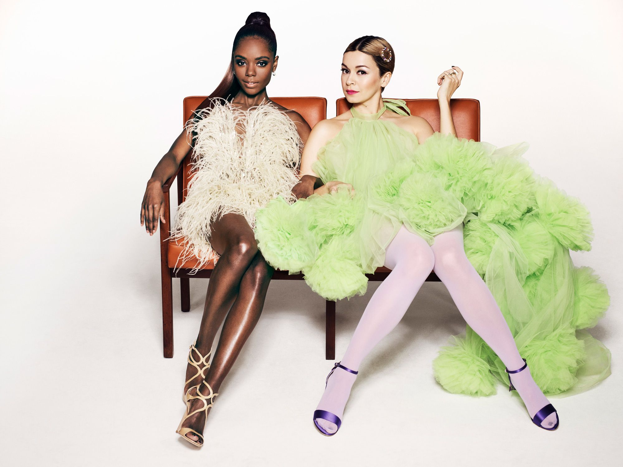 Ashleigh Murray and Julia Chan sitting on a bench.