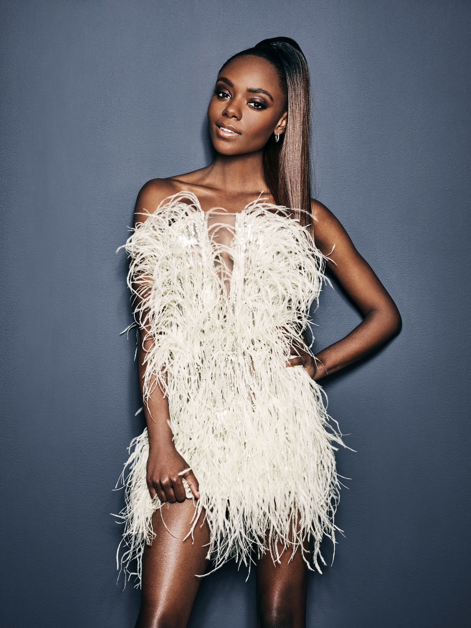 Ashleigh Murray modeling a feather dress.