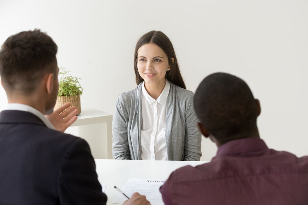 """Woman answers the interview question, """"Why are you interested in this position?"""""""