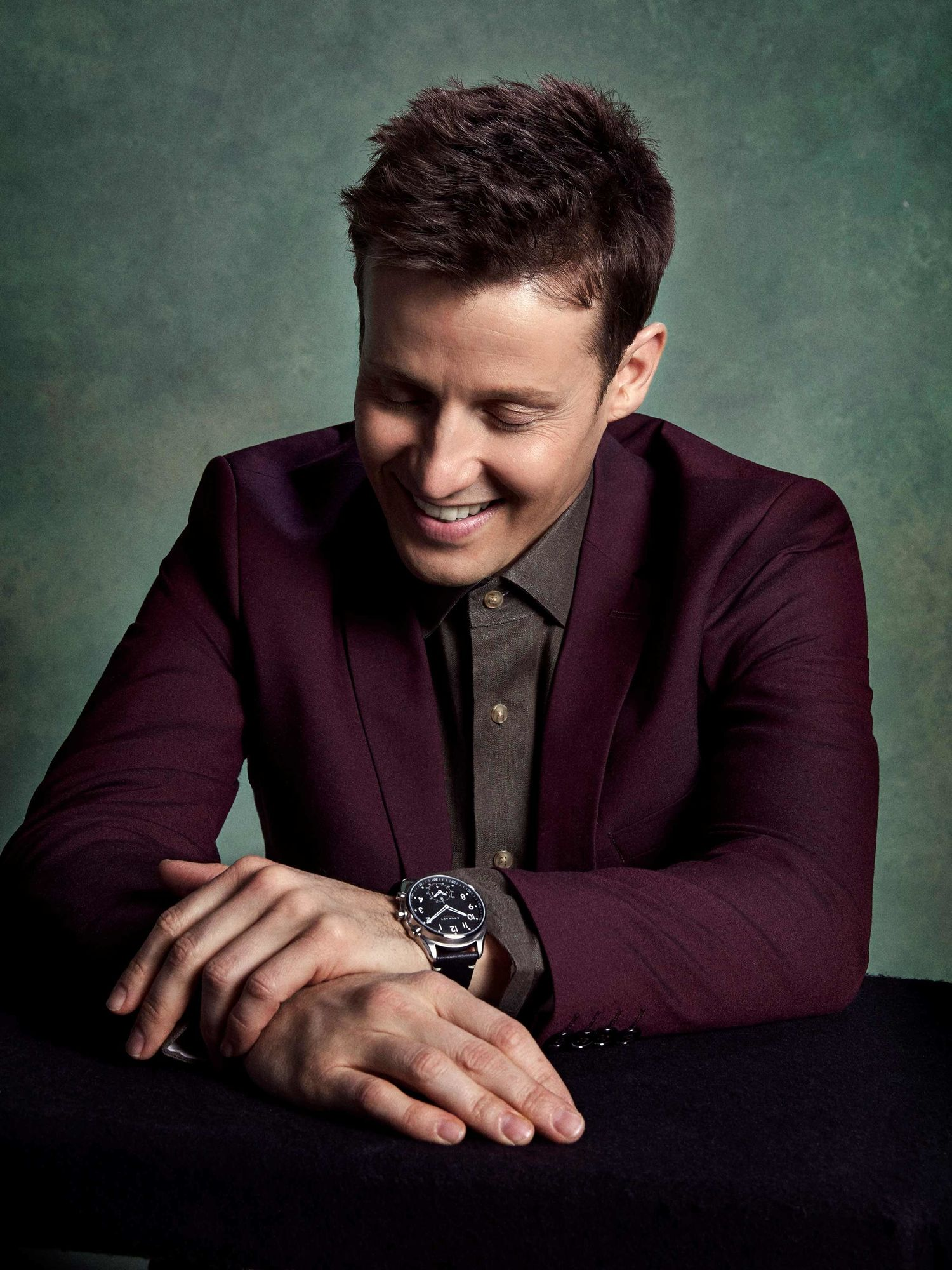 Will Estes in a maroon sports jacket