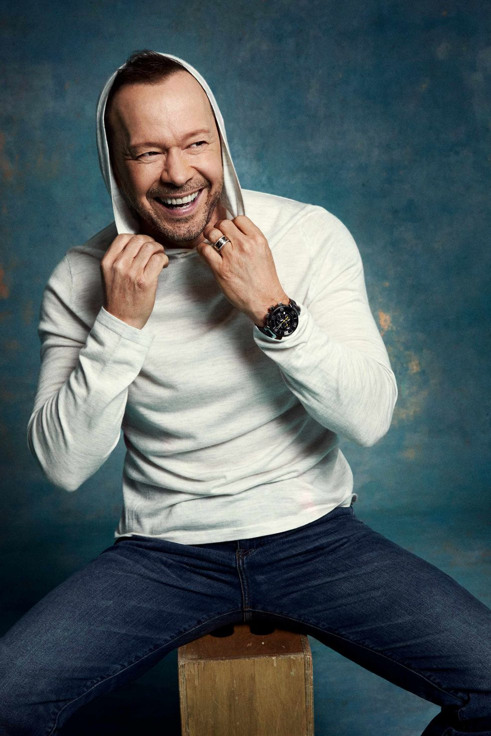 Donnie Wahlberg in a hoodie and jeans.