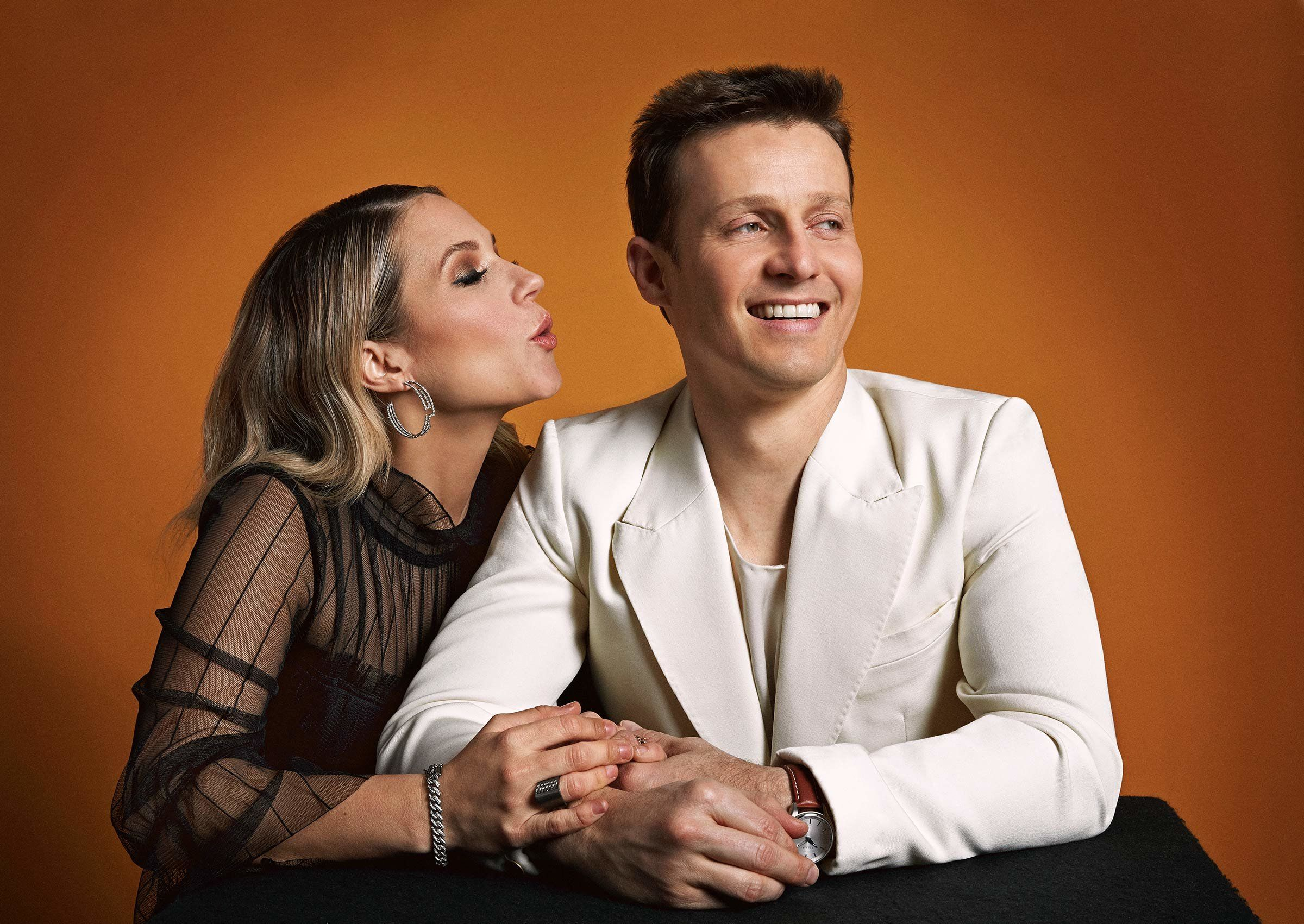 Vanessa Ray in a black dress and Will Estes in white suit.