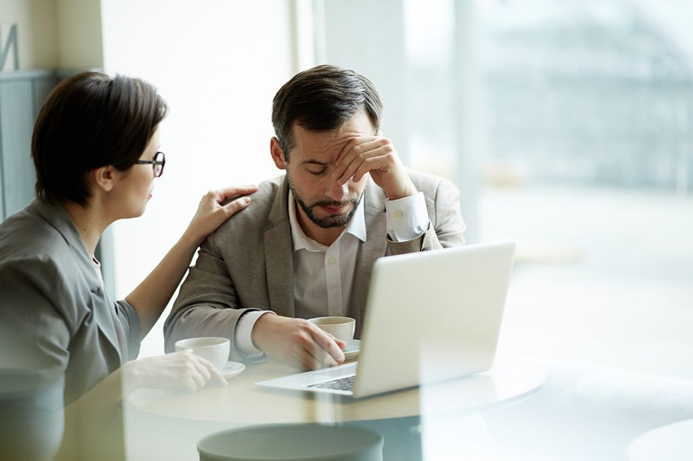 A manager consoles an employee during a time of need.