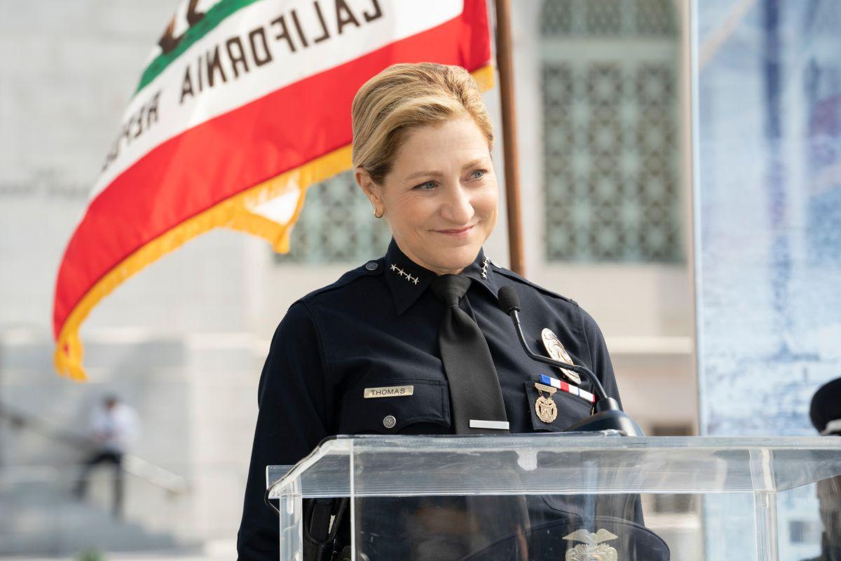 Edie Falco in a police uniform.