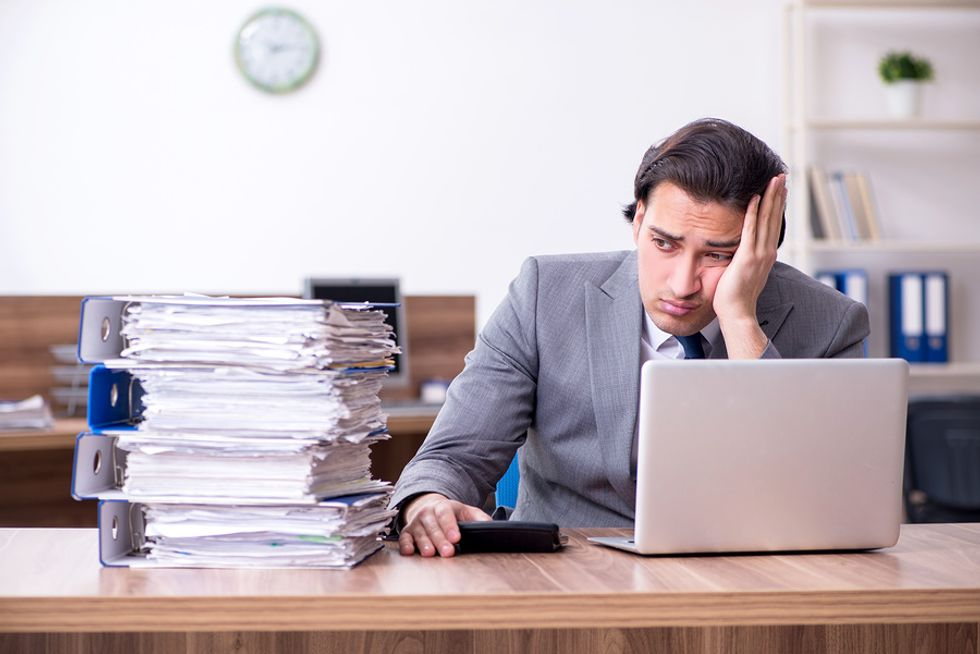 Professional man is overworked and wants a better work-life balance