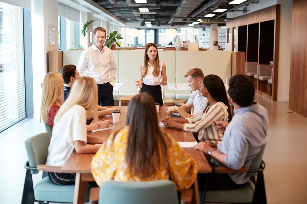 Hiring manager talks to job candidates during a group interview