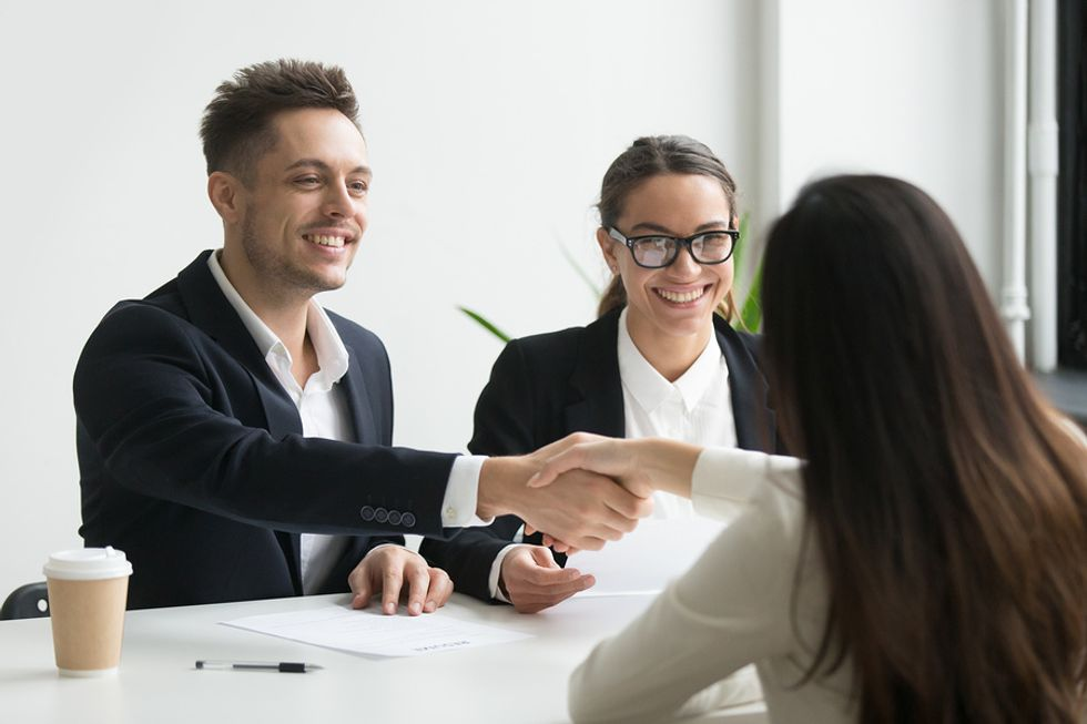 Woman thanks the hiring manager after a group interview