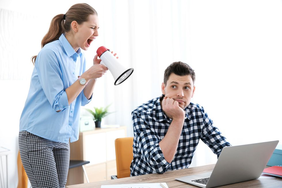 Woman annoying her co-worker