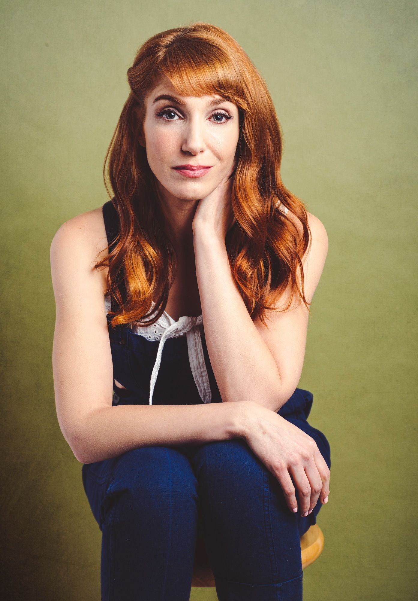 Actress Gwen Hollander from SHOWTIME series Kidding sitting on a stool.