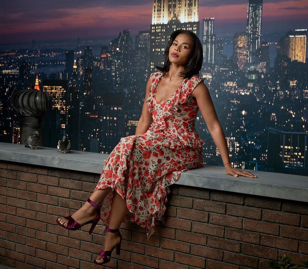 Roxy Sternberg sitting on a rooftop ledge.