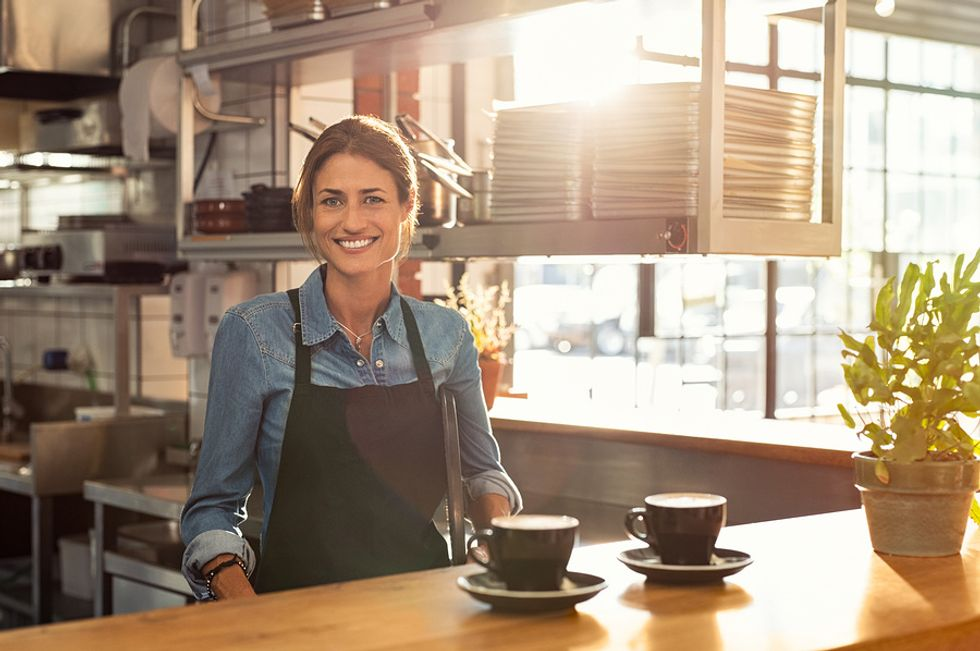 Woman entrepreneur working at her own restaurant