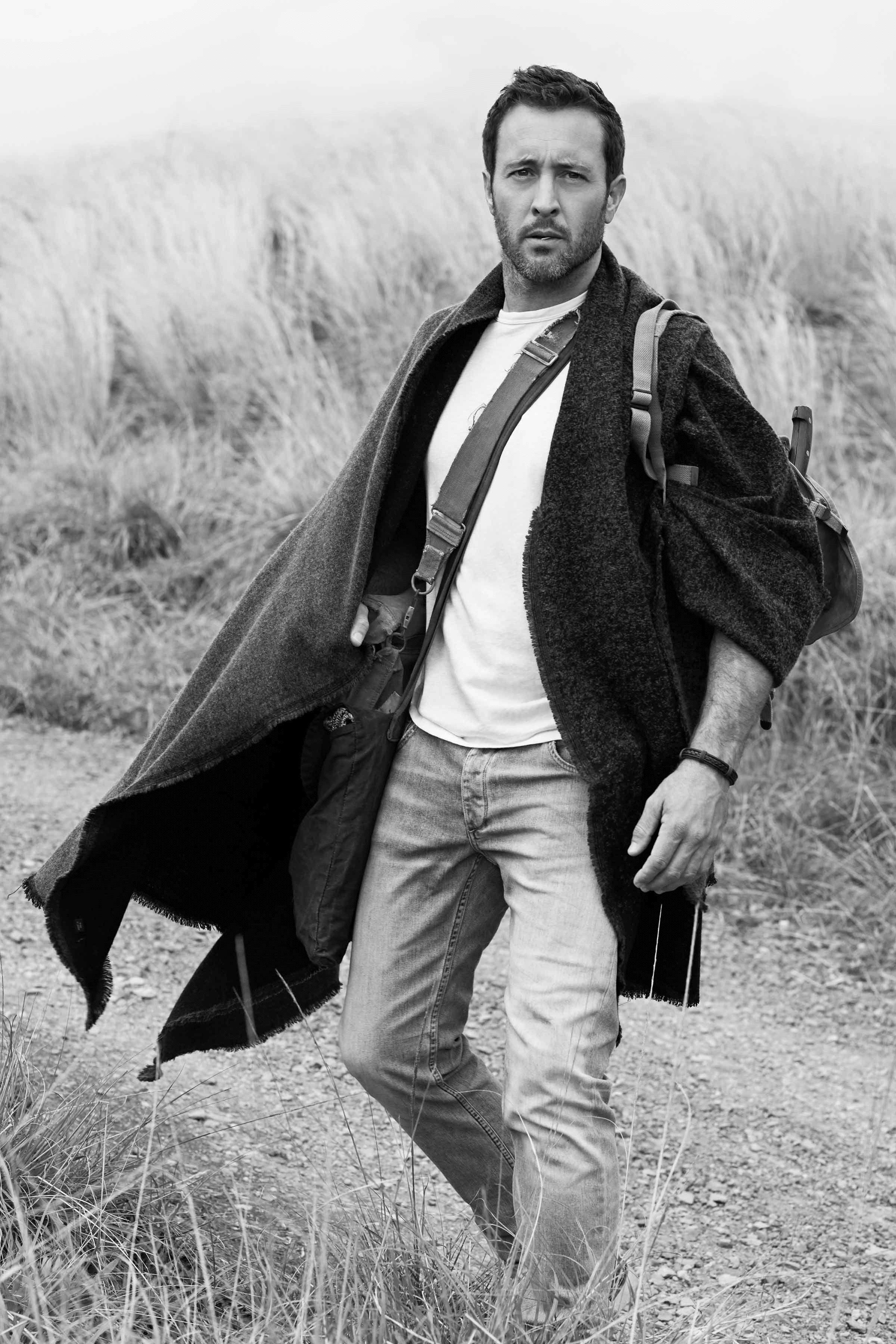 Black and white photo of Alex O'Loughlin hiking.