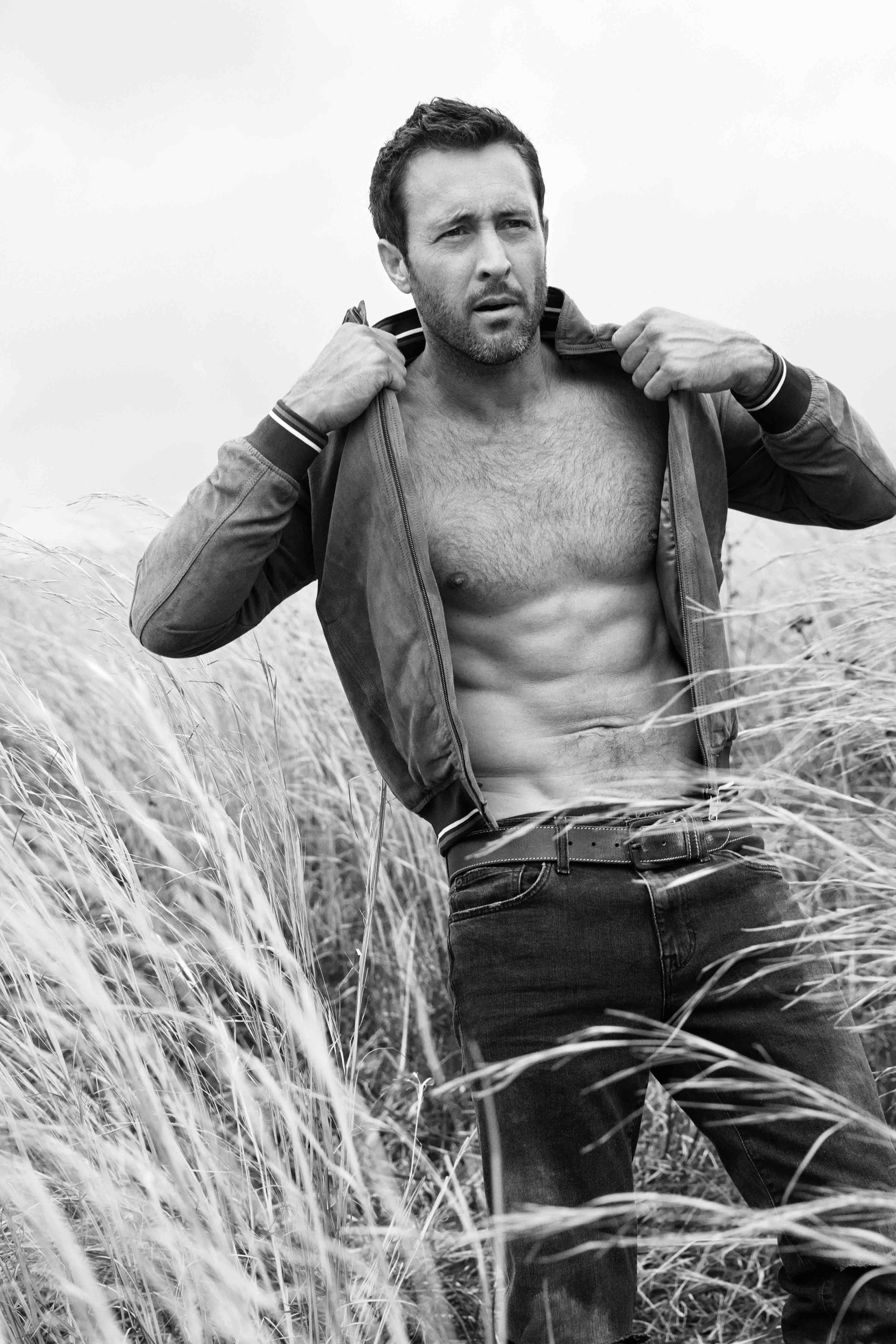 Black and white photo of Alex O'Loughlin shirtless.