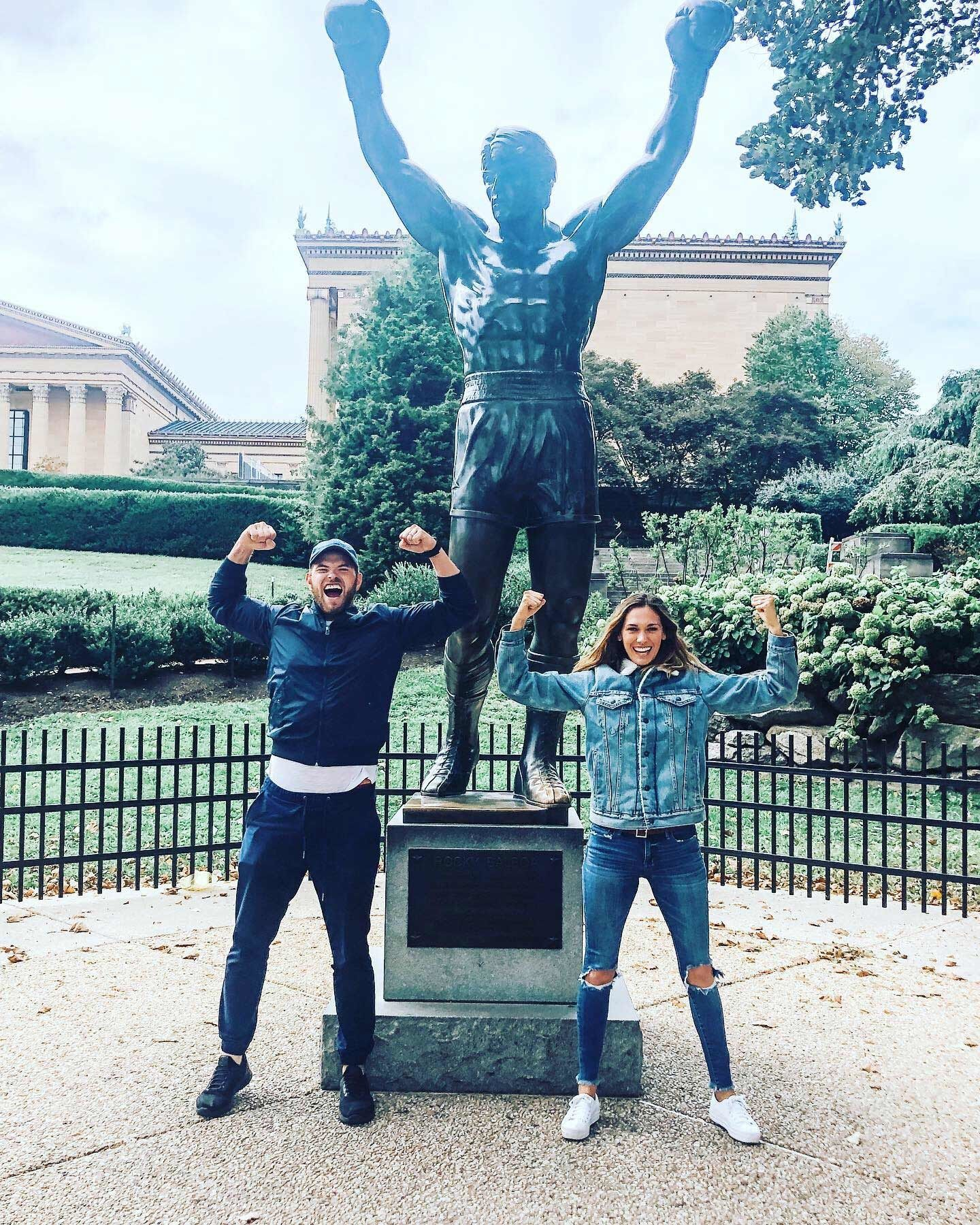 Kellan Lutz and wife in Philadelphia in front of Rocky statue.