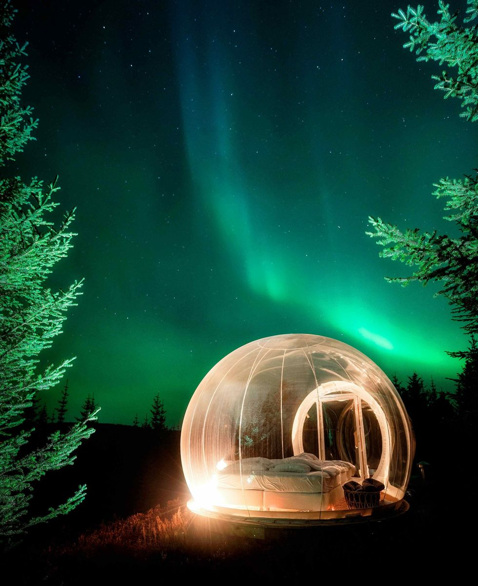 See-through Buuble hotel room in Iceland with the Northern Lights above.