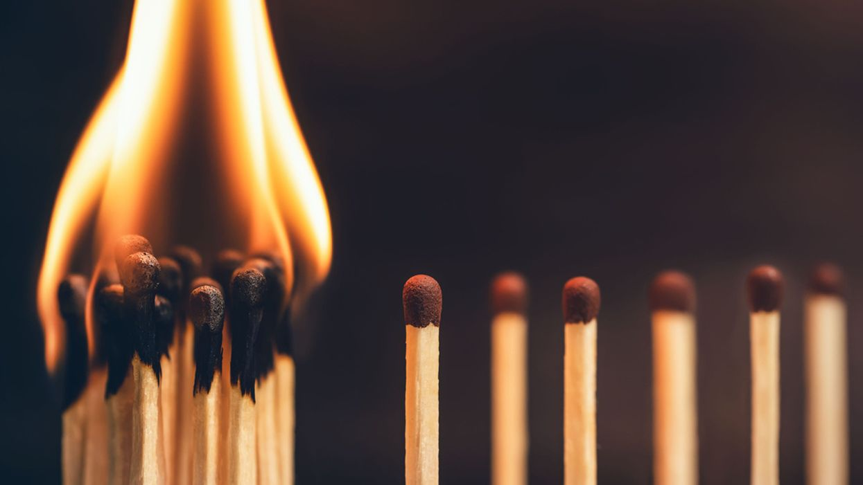 concept of social distancing matches burning all together with some standing apart COVID-19