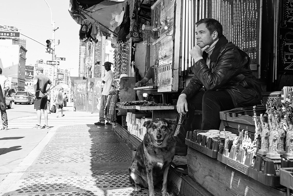 Black and white photo with Michael Weatherly and a dog in New York City.