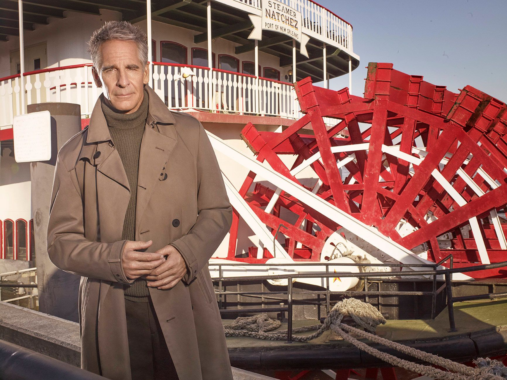 Scott Bakula in front a New Orleans paddleboat.