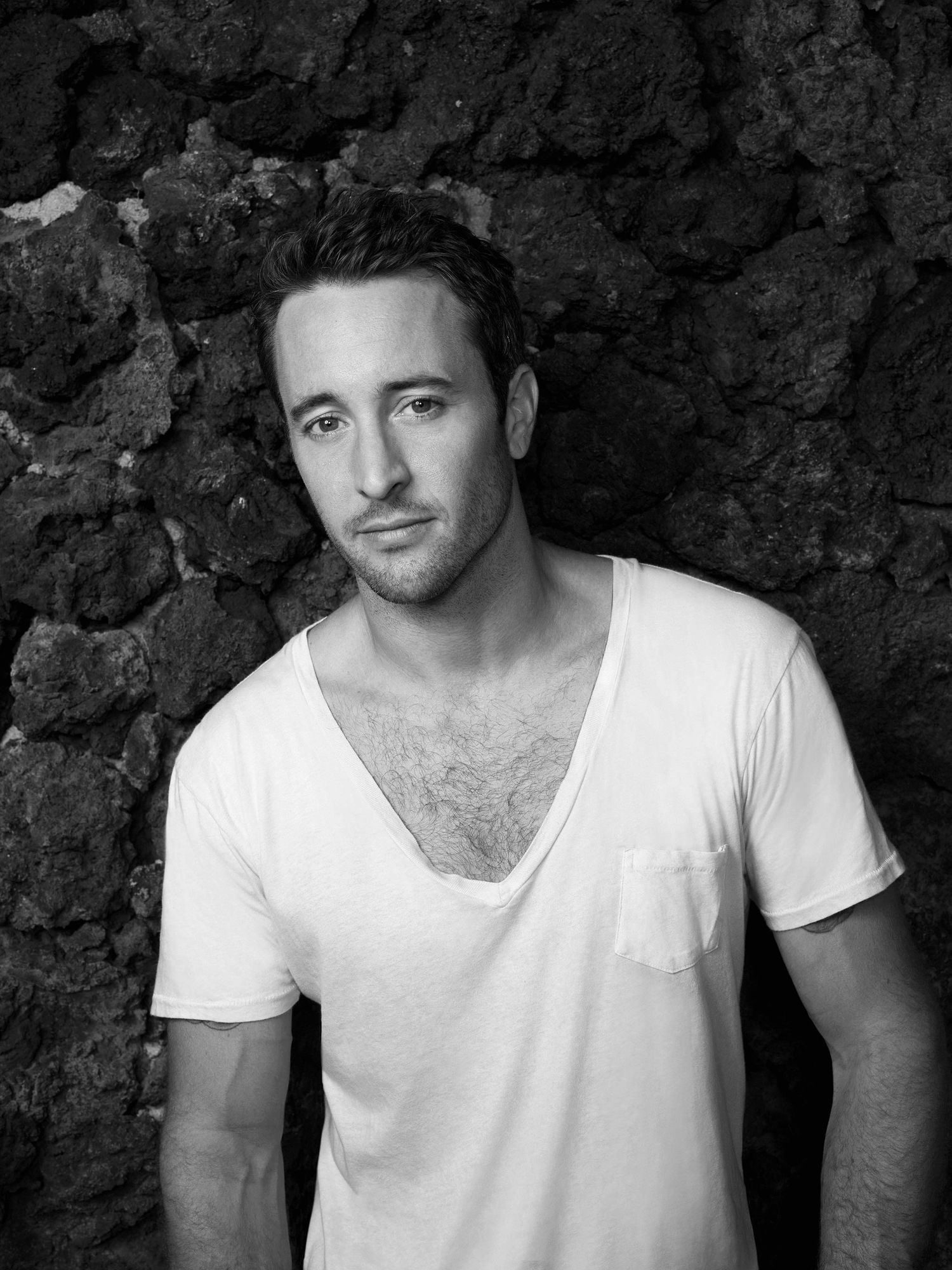 Black and white portrait of Alex OLoughlin.
