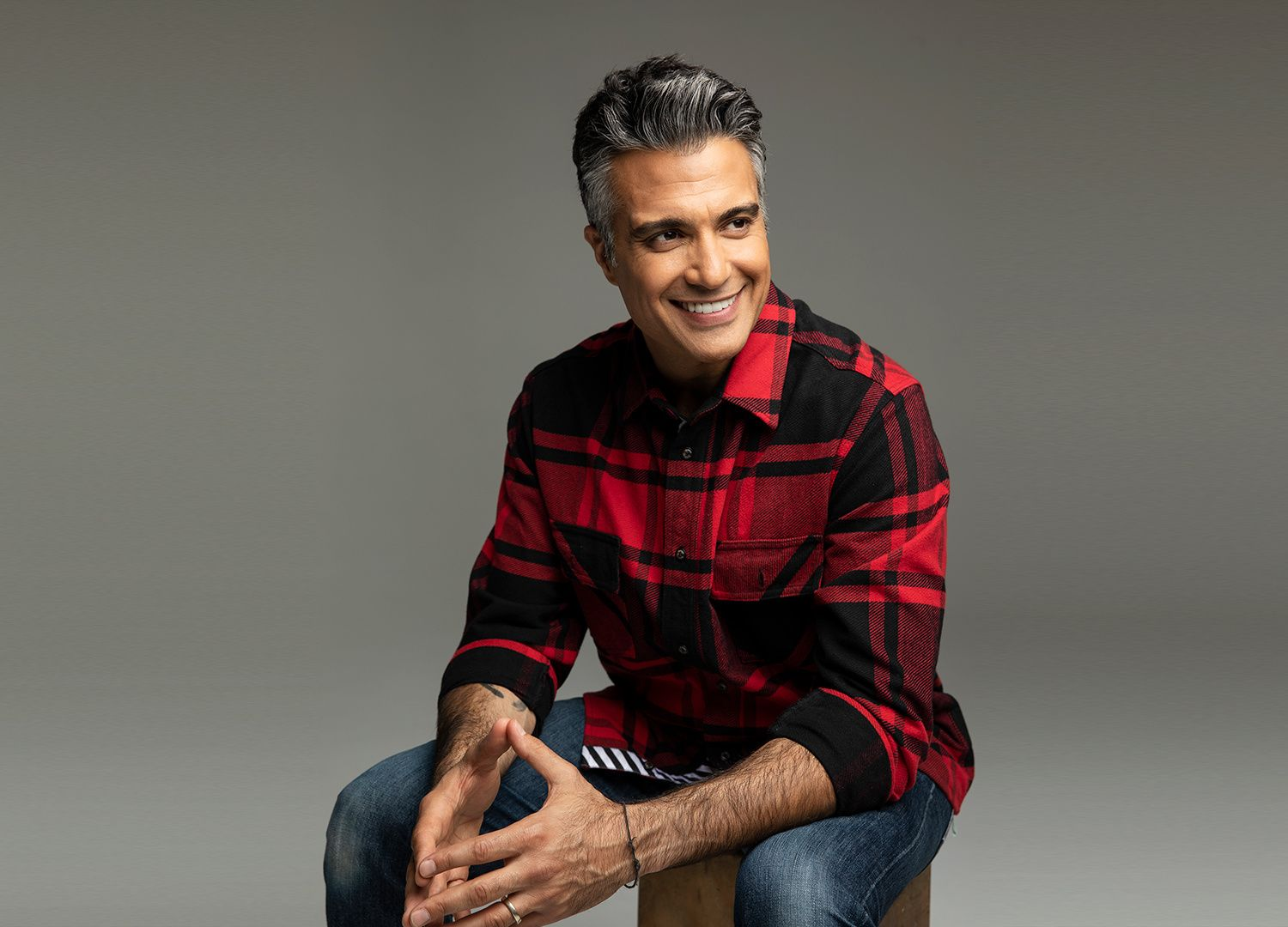 Actor Jaime Camil wearing a flannel.