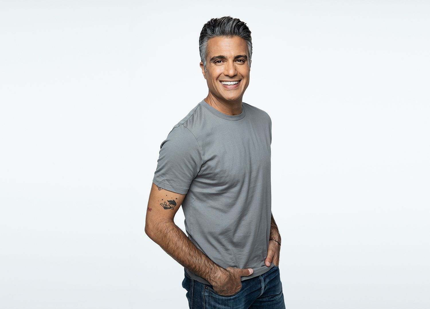 Actor Jaime Camil in a T-shirt and jeans.