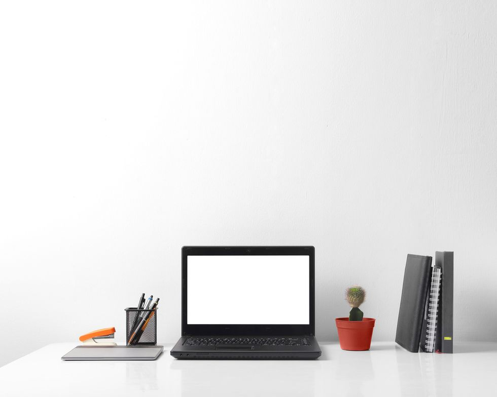 concept of clean and organized desk laptop and clean desk on white table and background