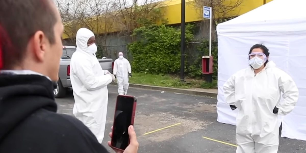 Dramatic video shows angry Louisville residents chasing away workers running fake coronavirus testing site