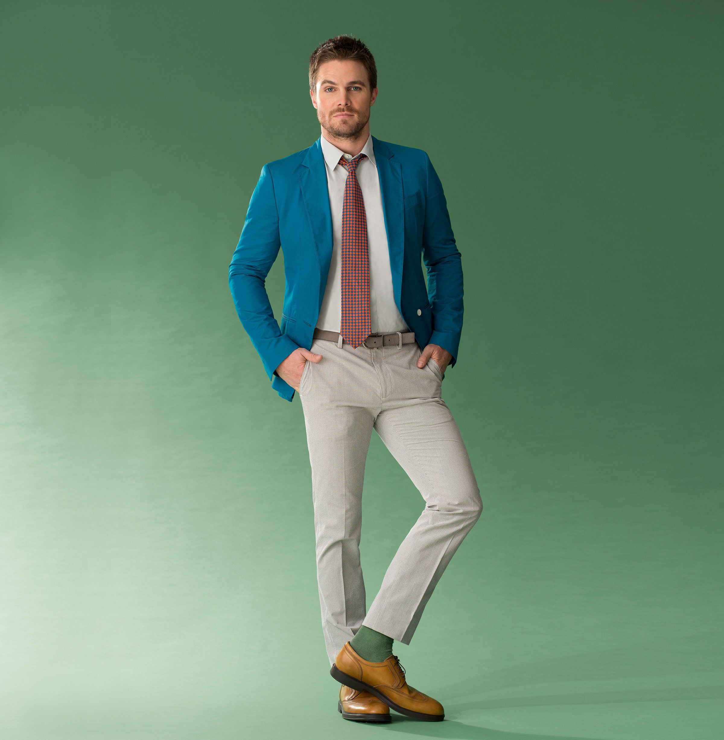 Actor Stephen Amell modeling a designer suit.