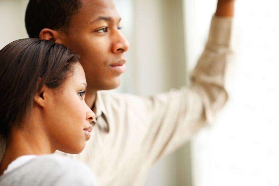 couple looks outside during quarantine
