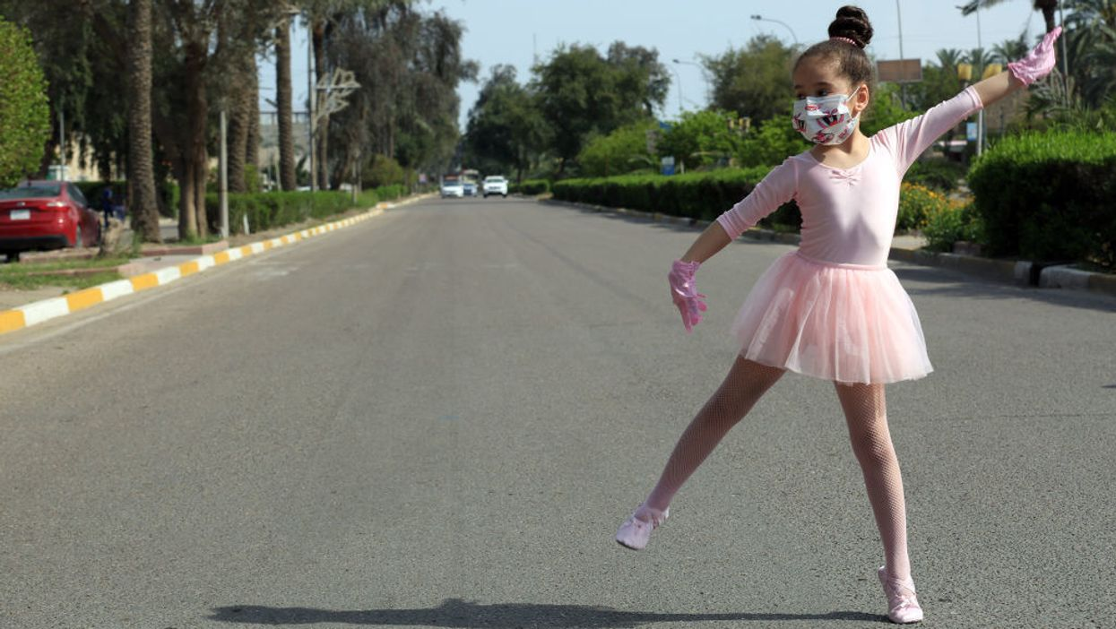 ballet dancer wearing protective face mask