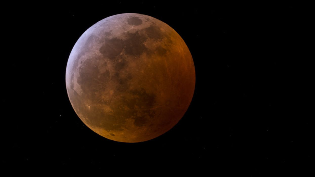 A total lunar eclipse accompanied the first in a trilogy of supermoons in 2019.