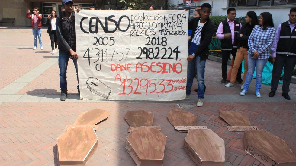 Afro-Colombian, Black, Raizal, and Palenquero civil-rights activists use mock coffins and statistics to protest erasure of Afro-descendants