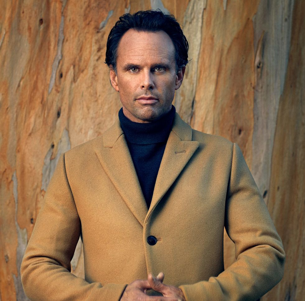 Walton Goggins headshot looking into the camera wearing a tan wool coat.