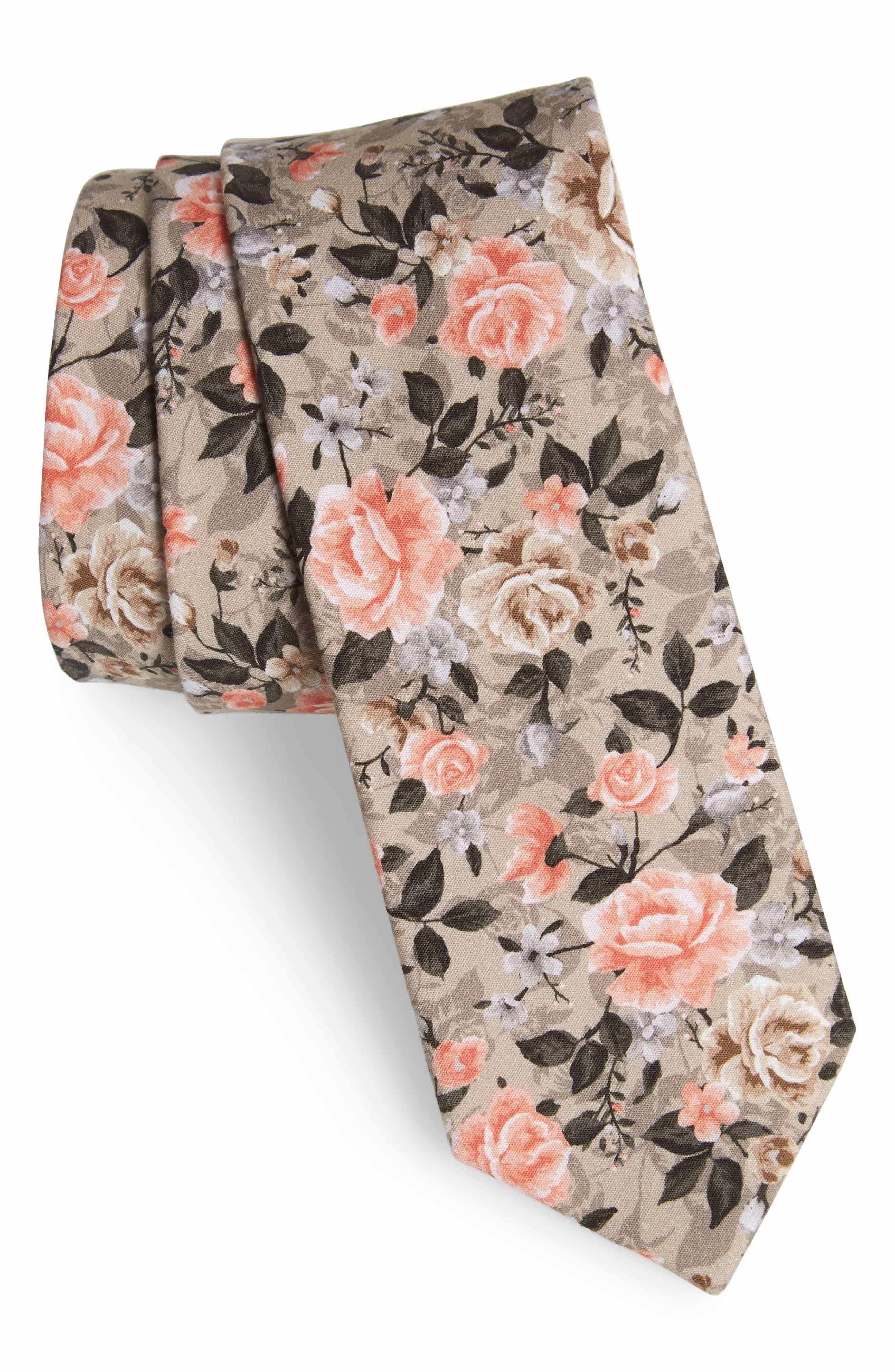 Floral print tie in pastel hues.