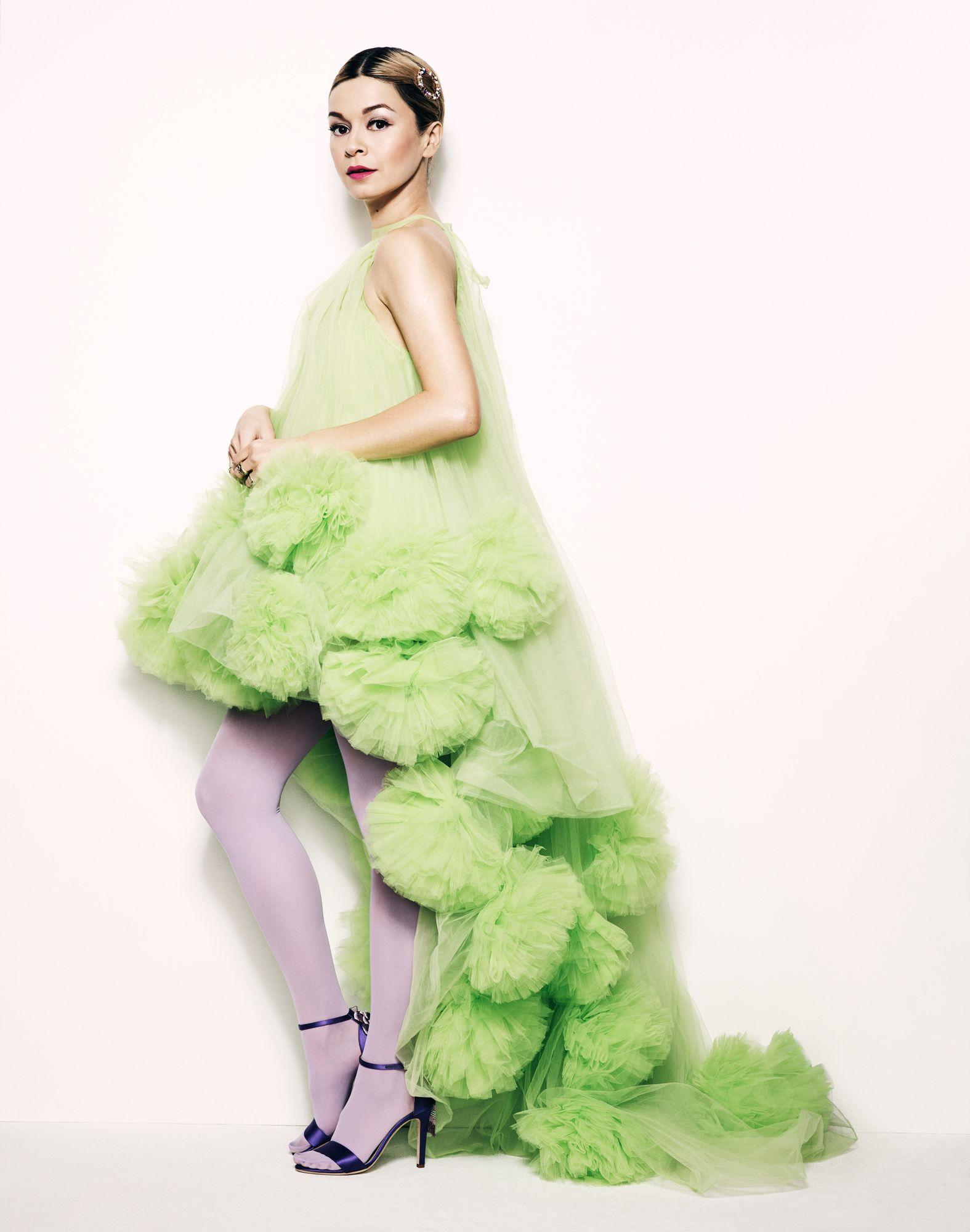 Julia Chan in a fluffly green chiffon dress.